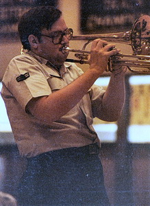 Jeff playing the valve trombone at a high school show in the Air Force band